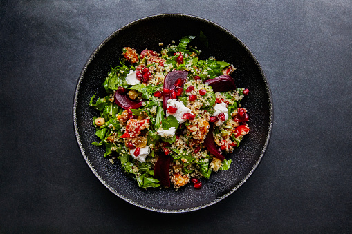 Quinoa salad with beet root and spinach. 937016542