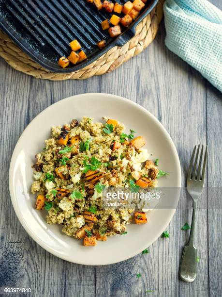 quinoa salad with roasted cauliflower,butternut squash - quinoa stock pictures, royalty-free photos & images