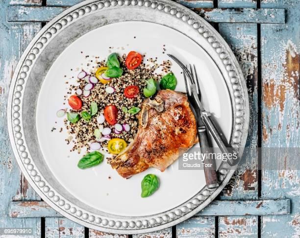 Quinoa salad with seared pork chops
