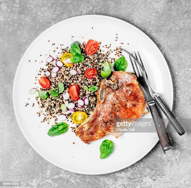 quinoa salad with seared pork chops - seared stock photos and pictures
