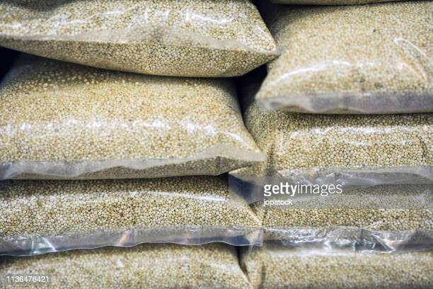 Quinoa seeds displayed for sale in a market stall