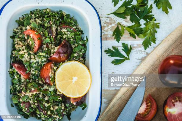 quinoa tabbouleh with lemon wheel - tabbouleh stock pictures, royalty-free photos & images