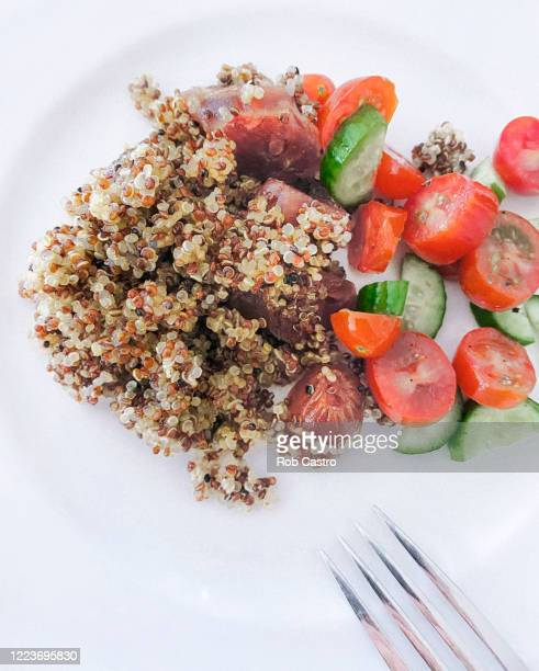 quinoa with chinese sausage - rob castro stock pictures, royalty-free photos & images