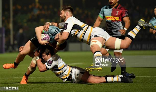 Quins player Cadan Murley is tackled by Francois Venter and Cornell du Preez during the Challenge Cup Quarter Final match between Worcester Warriors...