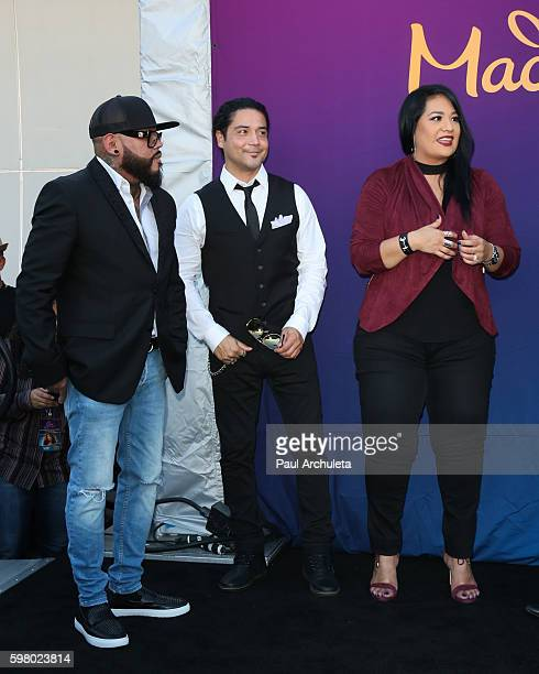 Quintanilla, Chris Perez and Suzette Quintanilla attend the unveiling of the Selena Quintanilla wax figure at The Madame Tussauds Hollywood on August...