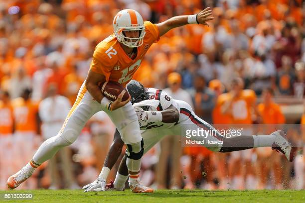 Quinten Dormady of the Tennessee Volunteers breaks a tackle from TJ Brunson of the South Carolina Gamecocks during the first half at Neyland Stadium...