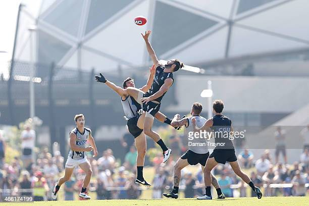 Quinten Lynch and Brodie Grundy battle in the ruck during a Collingwood Magpies AFL preseason intraclub match at Olympic Park on February 1 2014 in...