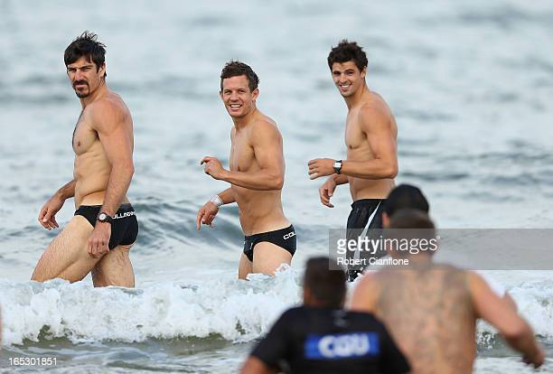 Quinten Lynch Luke Ball and Scott Pendlebury of the Magpies walk in the water during a Collingwod Magpies AFL recovery session at the St Kilda Sea...