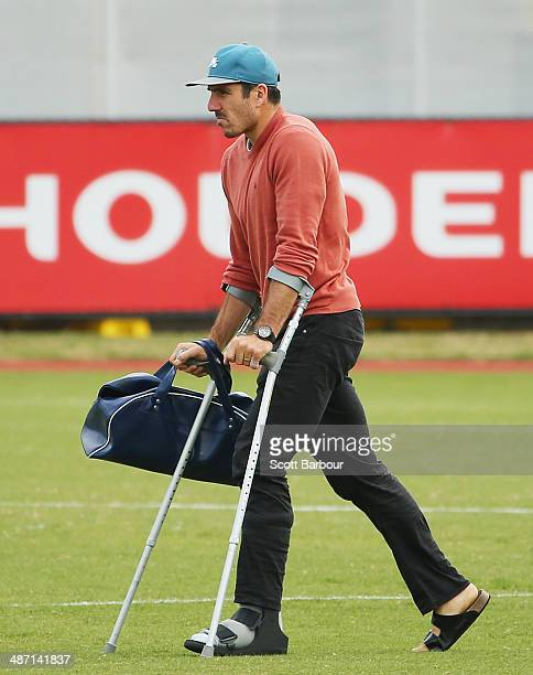 Quinten Lynch of the Magpies leaves on crutches during a Collingwood Magpies AFL training session at Gosch's Paddock on April 28 2014 in Melbourne...