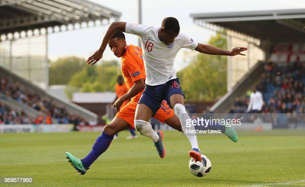 Quinten Maduro of the Netherlands and Rayhaan Tulloch of England challenge for the ball during the UEFA European Under-17 Championship Semi Final...