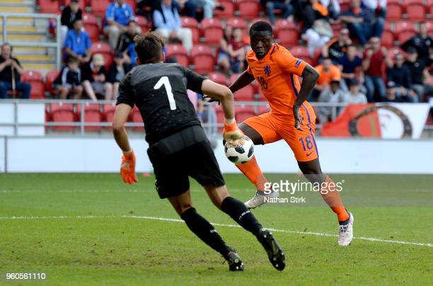 Quinten Maduro of the Netherlands scores his sides second goal past Alessandro Russo of Italy during the UEFA European Under17 Championship Final...
