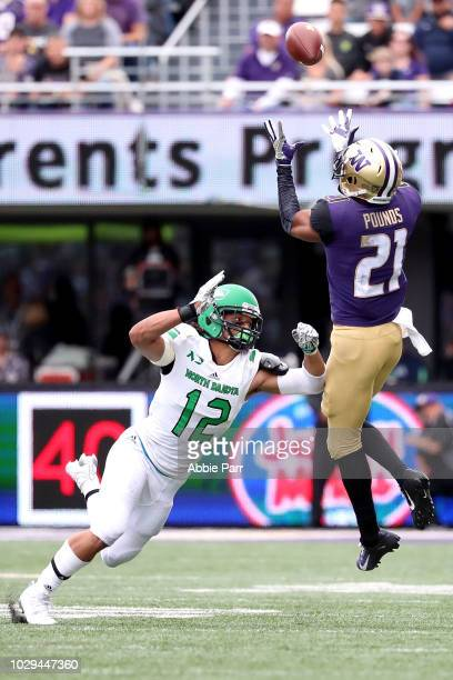 Quinten Pounds of the Washington Huskies catches the ball against Hayden Blubaugh of the North Dakota Fighting Sioux in the second quarter during...