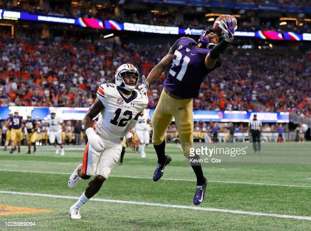 Quinten Pounds of the Washington Huskies pulls in this touchdown reception against Jamel Dean of the Auburn Tigers at Mercedes-Benz Stadium on...