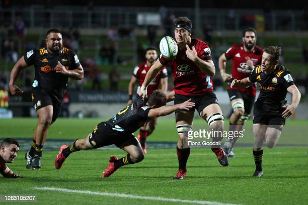Quinten Strange of the Crusaders juggles the ball near the line during the round eight Super Rugby Aotearoa match between the Chiefs and Crusaders at...