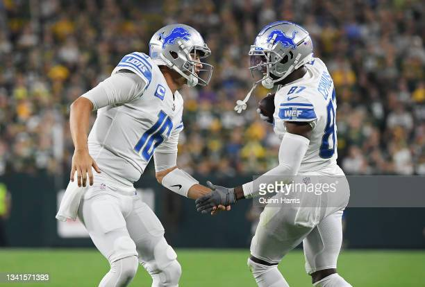 Quintez Cephus of the Detroit Lions celebrates a touchdown with teammate Jared Goff during the first half against the Green Bay Packers at Lambeau...