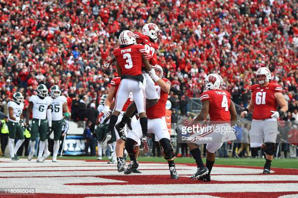 Quintez Cephus of the Wisconsin Badgers celebrates a touchdown with Kendric Pryor of the Wisconsin Badgers during the first half against the Michigan...