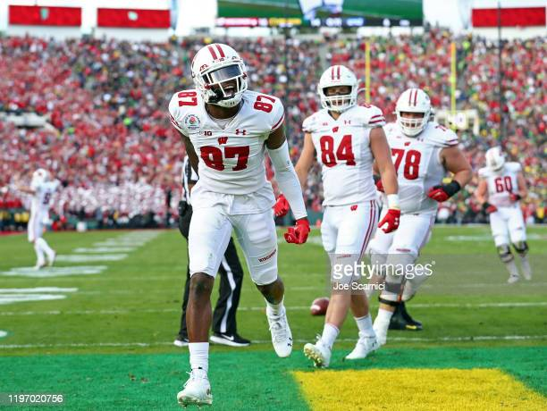 Quintez Cephus of the Wisconsin Badgers celebrates after scoring a 11 yard touchdown against the Oregon Ducks during the second quarter in the Rose...