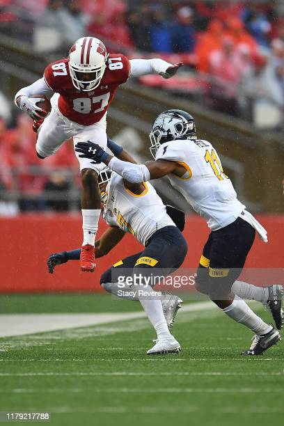 Quintez Cephus of the Wisconsin Badgers leaps over Jamal Parker of the Kent State Golden Flashes during the second half of a game at Camp Randall...