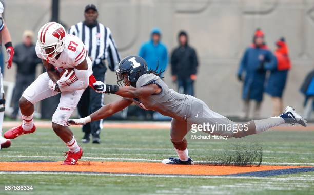 Quintez Cephus of the Wisconsin Badgers runs the ball after a reception as Jaylen Dunlap of the Illinois Fighting Illini tries to make the stop at...