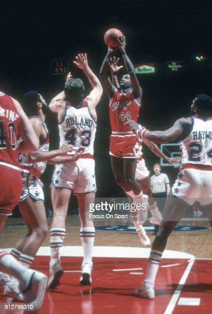 Quintin Dailey of the Chicago Bulls shoots over Jeff Ruland of the Washington Bullets during an NBA basketball game circa 1982 at the Capital Centre...