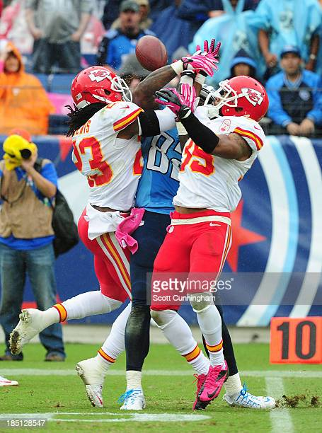 Quintin Demps and Kendrick Lewis of the Kansas City Chiefs break up a pass for Delanie Walker of the Tennessee Titans at LP Field on October 6, 2013...