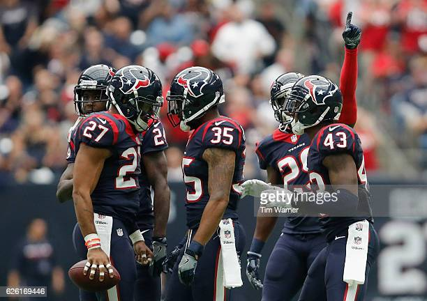 Quintin Demps of the Houston Texans and Eddie Pleasant of the Houston Texans celebrate after an interception in the third quarter at NRG Stadium on...