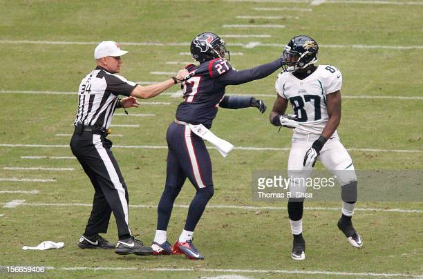Quintin Demps of the Houston Texans hits Kevin Elliott of the Jacksonville Jaguars after the play on November 18, 2012 at Reliant Stadium in Houston,...