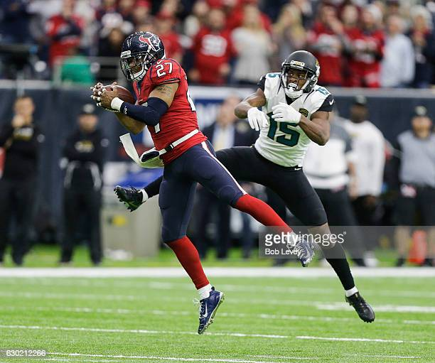 Quintin Demps of the Houston Texans intercepts a pass intended for Allen Robinson of the Jacksonville Jaguars in the fourth quarter at NRG Stadium on...