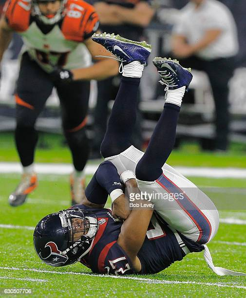 Quintin Demps of the Houston Texans intercepts the ball in the fourth quarter against the Cincinnati Bengals at NRG Stadium on December 24 2016 in...