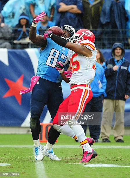 Quintin Demps of the Kansas City Chiefs breaks up a pass for Delanie Walker of the Tennessee Titans at LP Field on October 6, 2013 in Nashville,...