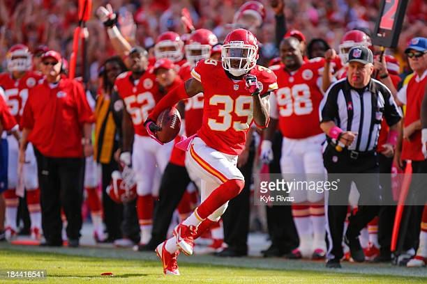 Quintin Demps of the Kansas City Chiefs intercepts a pass and returns it for a touchdown against the Oakland Raiders in the fourth quarter October...
