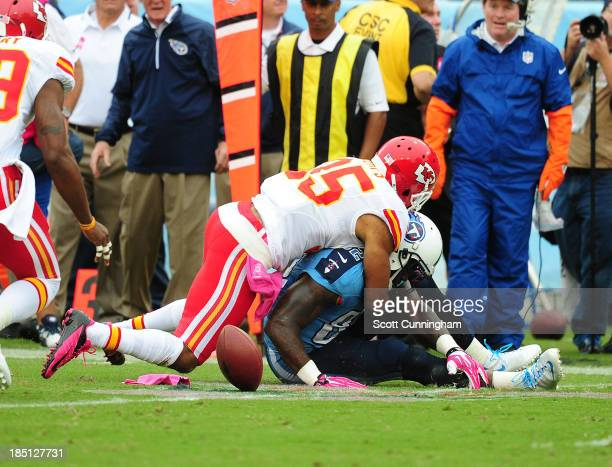 Quintin Demps of the Kansas City Chiefs knocks the ball loose from Delanie Walker of the Tennessee Titans at LP Field on October 6, 2013 in...