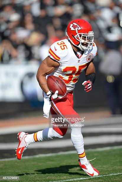 Quintin Demps of the Kansas City Chiefs returns a kickoff against the Oakland Raiders during the first quarter at Oco Coliseum on December 15 2013 in...