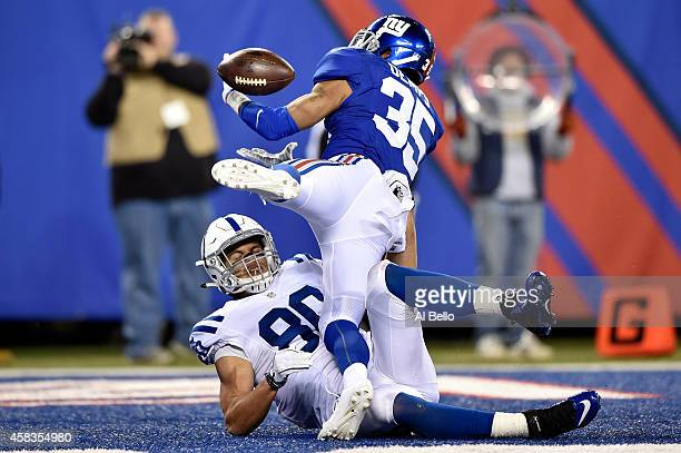 Quintin Demps of the New York Giants drops a pass in the end zone in the second quarter against the Indianapolis Colts during their game at MetLife...