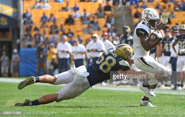 Quintin Wirginis of the Pittsburgh Panthers attempts to tackle Omahri Jarrett of the Georgia Tech Yellow Jackets in the fourth quarter during the...