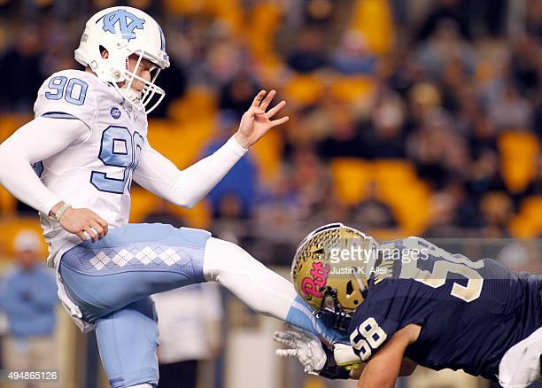 Quintin Wirginis of the Pittsburgh Panthers blocks a punt by Corbin Daly of the North Carolina Tar Heels in the second half during the game on...