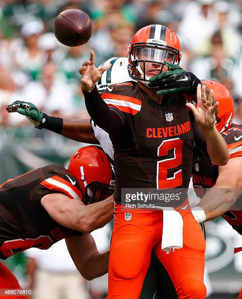 Quinton Coples of the New York Jets grabs quarterback Johnny Manziel of the Cleveland Browns just after he released a pass during the third quarter...