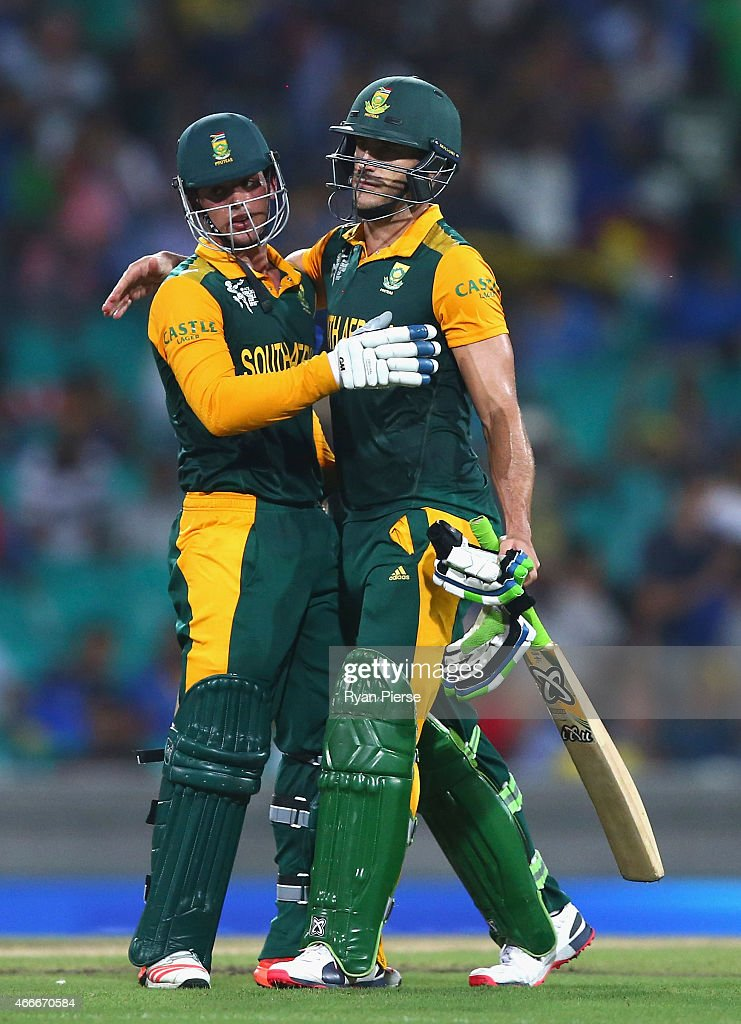 Quinton de Kock and Faf du Plessis of South Africa celebrate victory during the 2015 ICC Cricket World Cup Quarter Final match between South Africa and Sri Lanka at Sydney Cricket Ground on March 18, 2015 in Sydney, Australia.