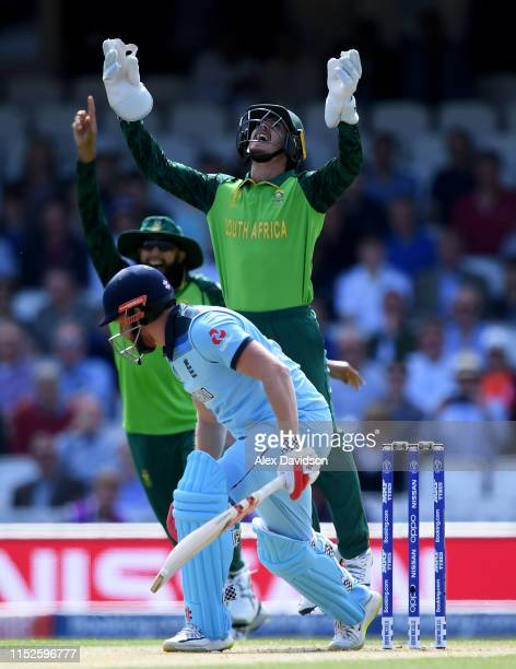 Quinton De Kock and Hashim Amla of South Africa celebrate the wicket of Jonny Bairstow of England off the bowling of Imran Tahir of South Africa...