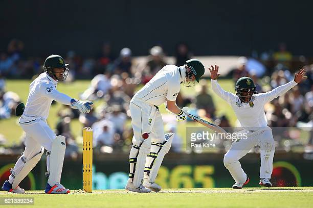 Quinton de Kock and Temba Bavuma of South Africa appeal for the lbw decision on Steve Smith of Australia during day four of the First Test match...