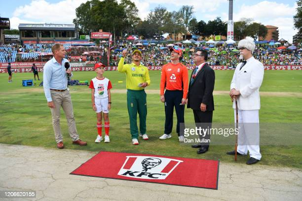 Quinton de Kock Captain of South Africa performs the coin toss with England Captain Eoin Morgan ahead of the Third T20 International match between...