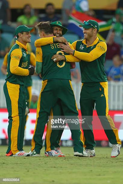 Quinton de Kock Hashim Amla and Faf du Plessis of South Africa celebrate with Dale Steyn of South Africa after he took the wicket of Ed Joyce of...