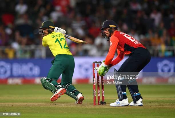 Quinton de Kock of South Africa bats as Jos Buttler of England keeps wicket during the Second T20 International match between England and South...