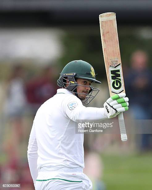 Quinton de Kock of South Africa celebrates after reaching his half century during day three of the Second Test match between Australia and South...