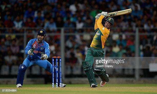 Quinton de Kock of South Africa hits out for six runs during the ICC Twenty20 World Cup warm up match between India and South Africa at Wankhede...