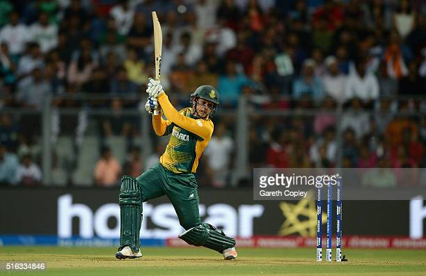 Quinton de Kock of South Africa hits out for six runs during the ICC World Twenty20 India 2016 Super 10s Group 1 match between South Africa and...