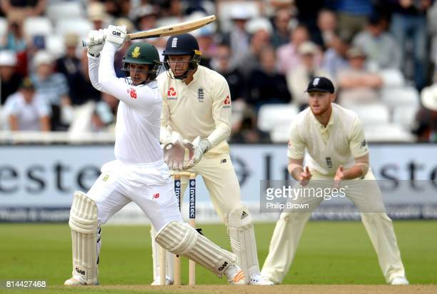Quinton de Kock of South Africa hits out watched by Jonny Bairstow and Ben Stokes of England during the 2nd Investec Test match between England and...