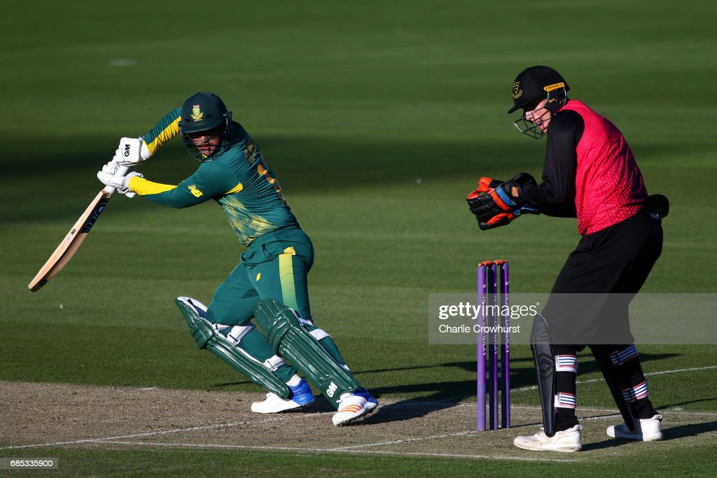 Quinton de Kock of South Africa hits out while Sussex wicket keeper Michael Burgess looks on during the Tour Match between Sussex and South Africa at The 1st Central County Ground on May 19, 2017 in Hove, England.