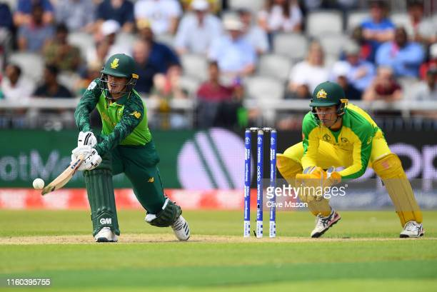 Quinton de Kock of South Africa in action batting as Alex Carey of Australia looks on during the Group Stage match of the ICC Cricket World Cup 2019...