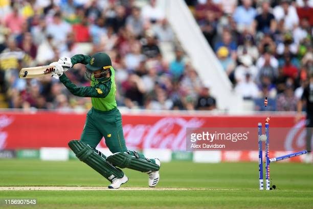 Quinton De Kock of South Africa is bowled by Trent Boult of New Zealand during the Group Stage match of the ICC Cricket World Cup 2019 between New...